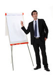 Businessman pointing to flip chart Royalty Free Stock Images