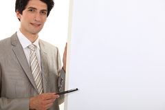 Businessman pointing to flip chart Stock Image