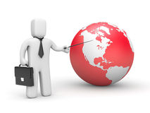 Businessman pointing to globe Royalty Free Stock Images