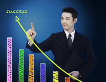 Businessman pointing to graph Stock Photo