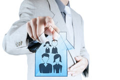 Businessman pointing to hand drawn family icon Stock Photography