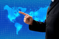 businessman pointing to his global business Stock Photos