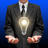 Businessman pointing to the illuminated bulb Royalty Free Stock Photo