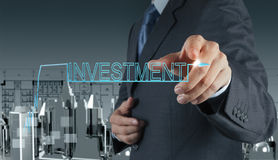Businessman  pointing to investment concept Stock Photo