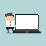 Businessman pointing to laptop display Royalty Free Stock Photo