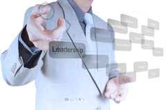 Businessman pointing to leadership skill concept on virtual scre Stock Images