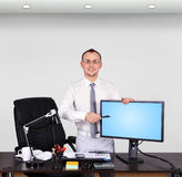 Businessman pointing to monitor Stock Photos