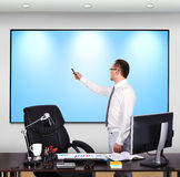 Businessman pointing to plasma panel Stock Images