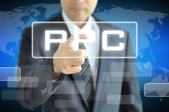 Businessman pointing to PPC or Pay Per Click Royalty Free Stock Image