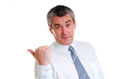 Businessman pointing to the right Stock Images