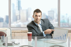 Businessman pointing to screen Royalty Free Stock Images