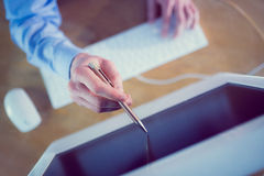 Businessman pointing to screen with pen Royalty Free Stock Photos