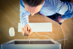Businessman pointing to screen with pen Stock Photography