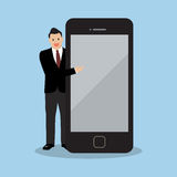 Businessman pointing to the screen of a smartphone Royalty Free Stock Image