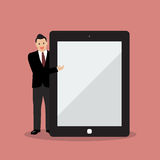 Businessman pointing to the screen of a tablet Royalty Free Stock Photos