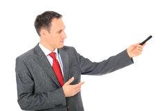 Businessman pointing to the side Royalty Free Stock Photos