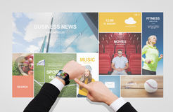 Businessman pointing to smart watch at his hand Stock Image