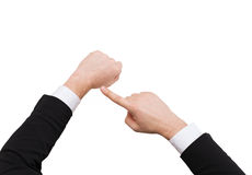 Businessman pointing to something at his hand. Time, business and new technology concept - close up of businessman pointing to something at his hand Royalty Free Stock Image