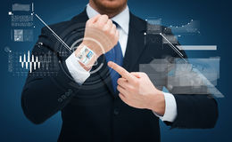 Businessman pointing to something at his hand royalty free stock images