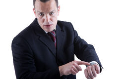 Businessman pointing to the watch Royalty Free Stock Images