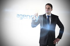 Businessman pointing to word agency Stock Photo