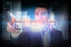 Businessman pointing to the word clear Stock Photos