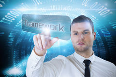 Businessman pointing to word framework Stock Image