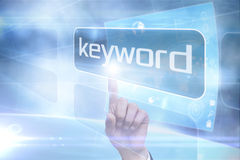 Businessman pointing to word keyword Royalty Free Stock Images