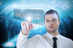 Businessman pointing to word objective Stock Photo