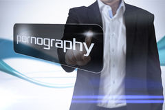 Businessman pointing to word pornography. Against abstract blue line son white background Stock Images