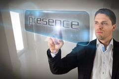 Businessman pointing to word presencece Royalty Free Stock Photo