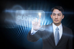 Businessman pointing to word publish Stock Images