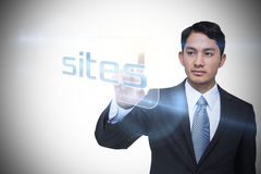 Businessman pointing to word sites Royalty Free Stock Photography