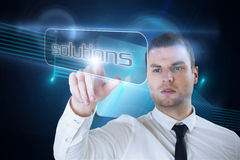 Businessman pointing to word solutions Stock Image