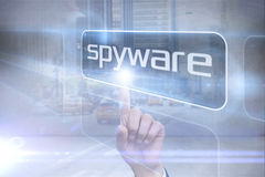 Businessman pointing to word spyware Stock Photo