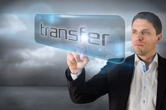 Businessman pointing to word transfer Stock Image