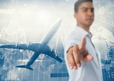 Businessman pointing touching air in front of plane flying with statistics Royalty Free Stock Photography