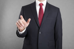 Businessman pointing or touching something Stock Photo