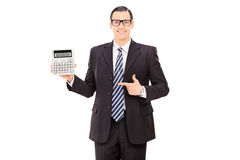 Businessman pointing towards a calculator Royalty Free Stock Photography