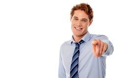 Businessman pointing towards camera Stock Photo