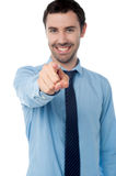 Businessman pointing towards camera Royalty Free Stock Image