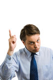 Businessman pointing up Stock Images