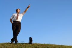 Businessman pointing up Stock Photography