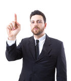 Businessman pointing up on white background Stock Images