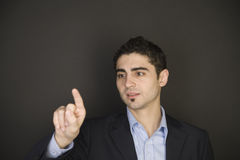 Businessman pointing on a virtual screen. On black background royalty free stock images