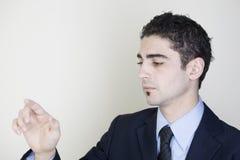 Businessman pointing on a virtual screen Stock Photos