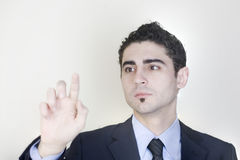 Businessman pointing on a virtual screen. On black background stock images