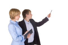 Businessman pointing at wall with woman near by Royalty Free Stock Photo