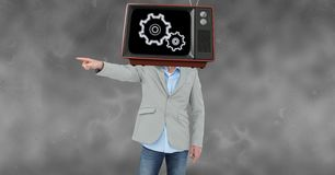 Businessman pointing while wearing TV on head Stock Images