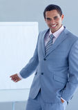 Businessman pointing at a whiteboard Stock Photo